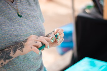 Adele Hare wraps wire around a jewl at the Vintage Market at Pierce College in Woodland Hills, Calif., on Sept. 22, 2019. Photo by Katya Castillo.