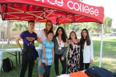 (Right to Left) Derek Laam, Jenni Severin, Vivian Yee, Jehan Ibrahem, Nicole Ray, and the teacher spectator of the Clothesline Project pose underneath their tent at Rocky Young Park at Pierce College Woodland Hills, Calif. on Oct. 16, 2019. Photo by: Kamryn Bouyett