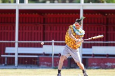 Chri Hammond dressed as a pineapple hits a pitch during Pierce College Baseball's Halloween Backwards Game at Joe Kelly Field in Woodland Hills, Calif. on Oct. 31, 2019. Photo by Benjamin Hanson.