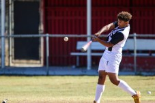Leon Jackson dressed as Cristiano Ronaldo hits a pitch during Pierce College Baseball's Halloween Backwards Game at Joe Kelly Field in Woodland Hills, Calif. on Oct. 31, 2019. Photo by Benjamin Hanson.