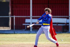 Joe Metcalf dressed as Superman hits a pitch during Pierce College Baseball's Halloween Backwards Game at Joe Kelly Field in Woodland Hills, Calif. on Oct. 31, 2019. Photo by Benjamin Hanson.