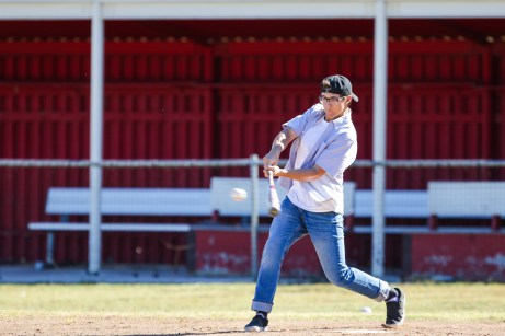 Bryce Clymber dressed as Bennny Rodriguez hits a pitch during Pierce College Baseball's Halloween Backwards Game at Joe Kelly Field in Woodland Hills, Calif. on Oct. 31, 2019. Photo by Benjamin Hanson.