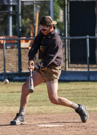 Zack Garcia swings at the ball during a split-squad Halloween game at Pierce College's Kelly Field on Oct. 31, 2019. Photo by Cecilia Parada.
