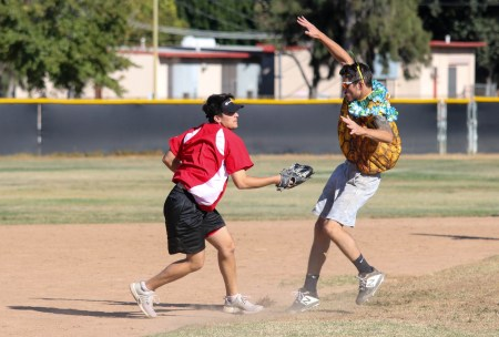 (Left to right) Kenny Baumgartner attempts to tag Chris Hammond during a split-squad Halloween game at Pierce College's Kelly Field on Oct. 31, 2019. Photo by Cecilia Parada.