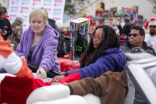 Volunteers collect toys at Motor 4 Toys at Pierce College's Parking Lot 7 in Woodland Hills, Calif. on Dec. 1, 2019. Photo by Cecilia Parada.