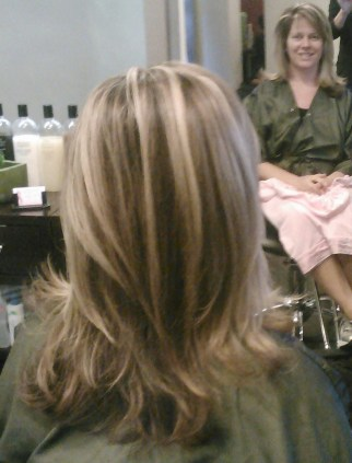 Dark blond base hair color, Blond Hi-lite, layered cut