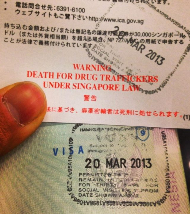 Singaporean passport insert warning of the death penalty for drug traffickers.