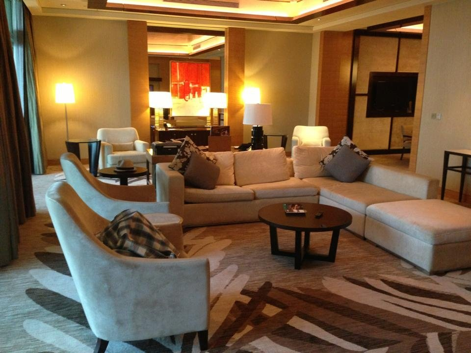 Our living room at the Marina Bay Sands. It's massive, with a huge couch and an office.