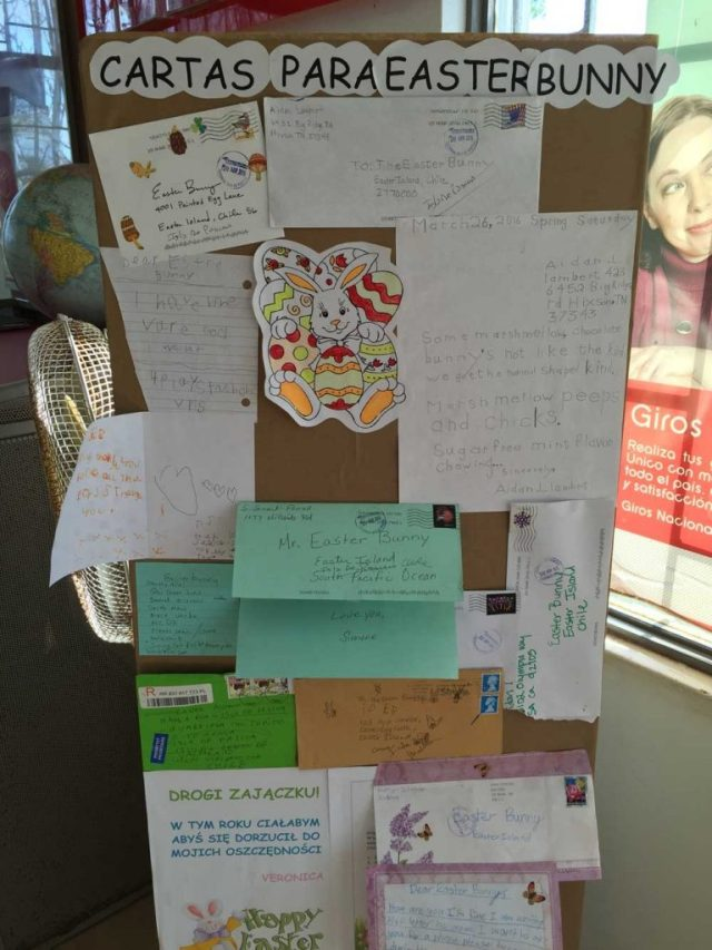 A bulletin board with letters to the Easter Bunny on display.