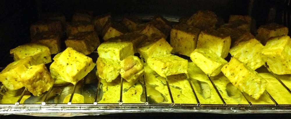 vegan tikka masala - roasting marinated tofu