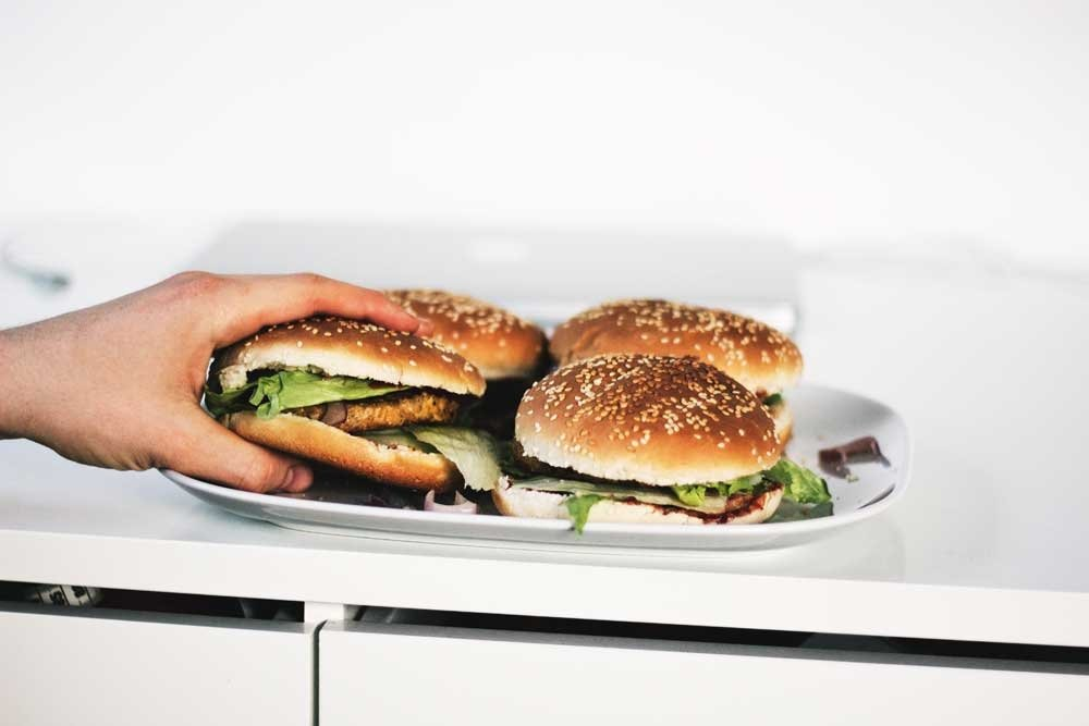 Save money for travel - eliminate fast food - two hamburgers on a plate