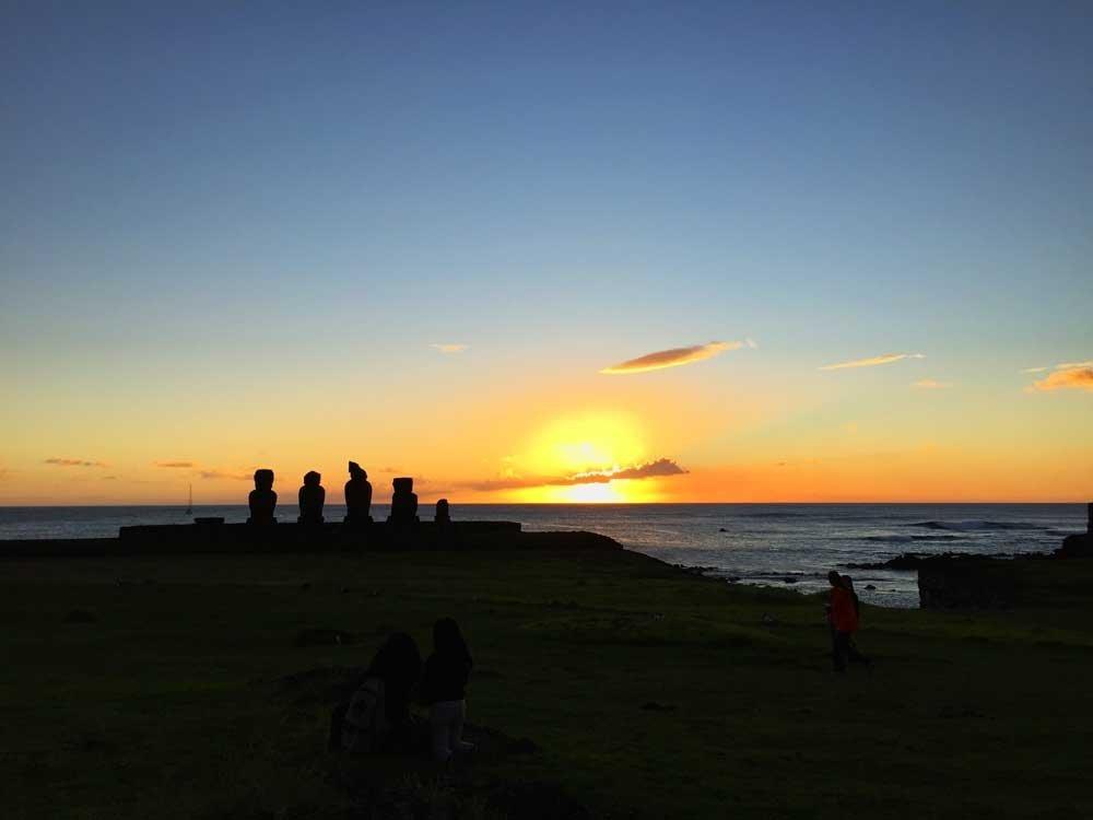 Sunset and moai silhouettes