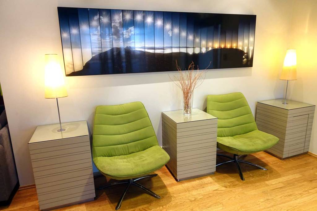 OSL Lounge seating area. Individual green chairs
