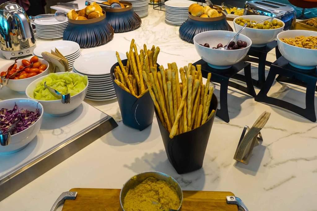 snacks, breadsticks, olives, hummus, salads