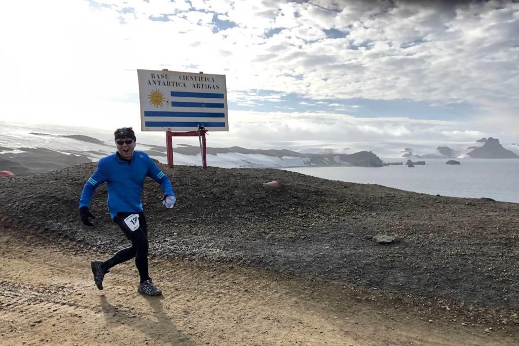 Halef running past the Uruguay Base sign