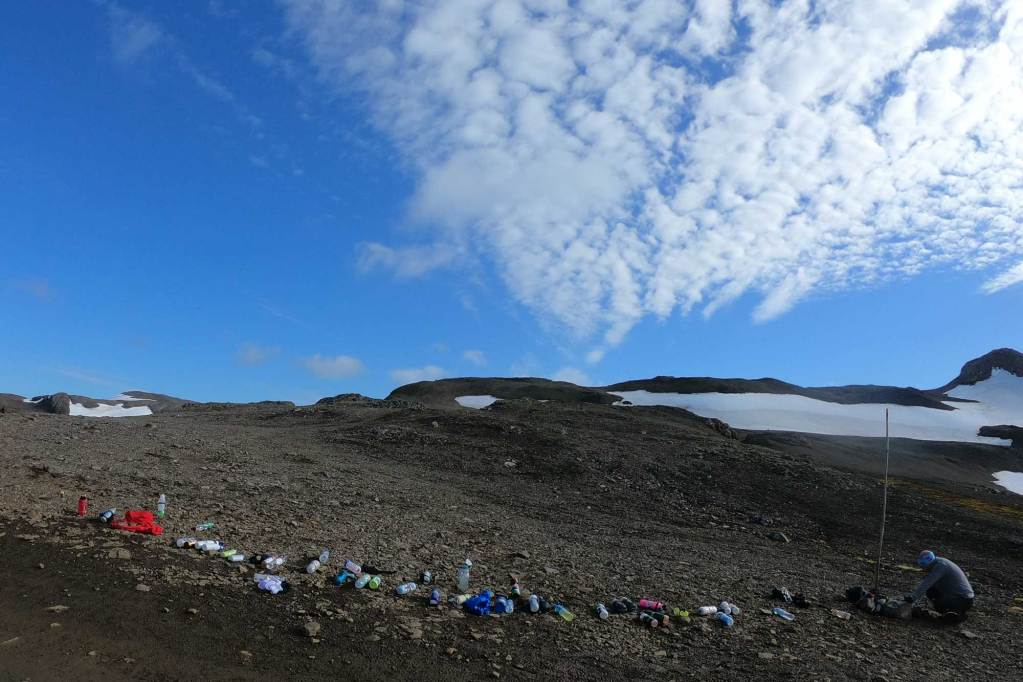 a water station along the antarctica marathon route. Just a line of bottles, really.