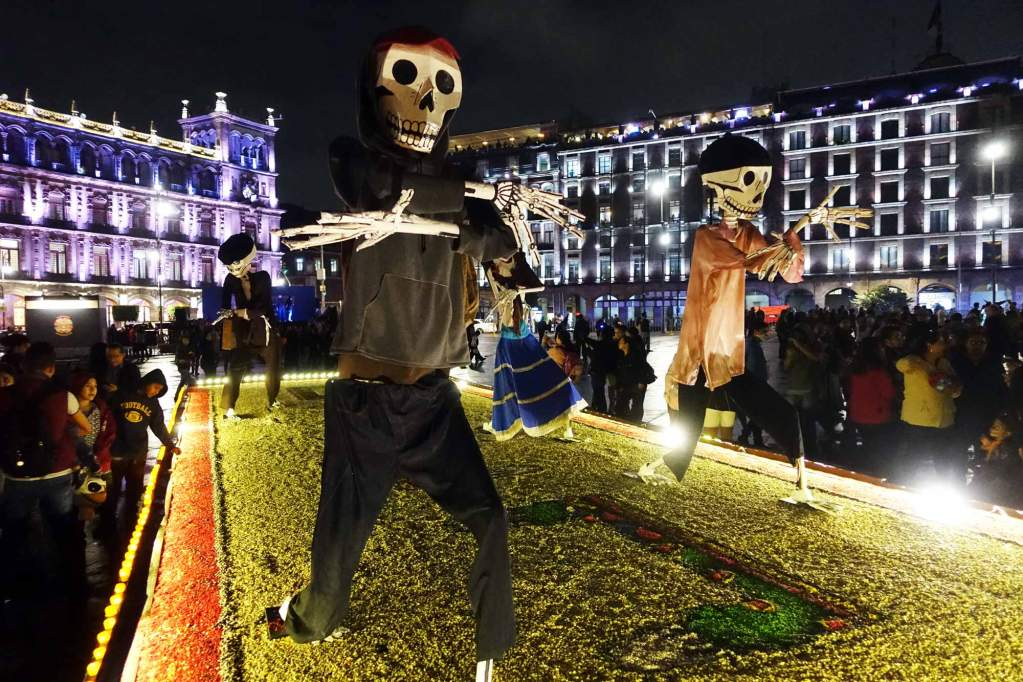 two skeletons dressed in streetwear in mexico city 's zocalo