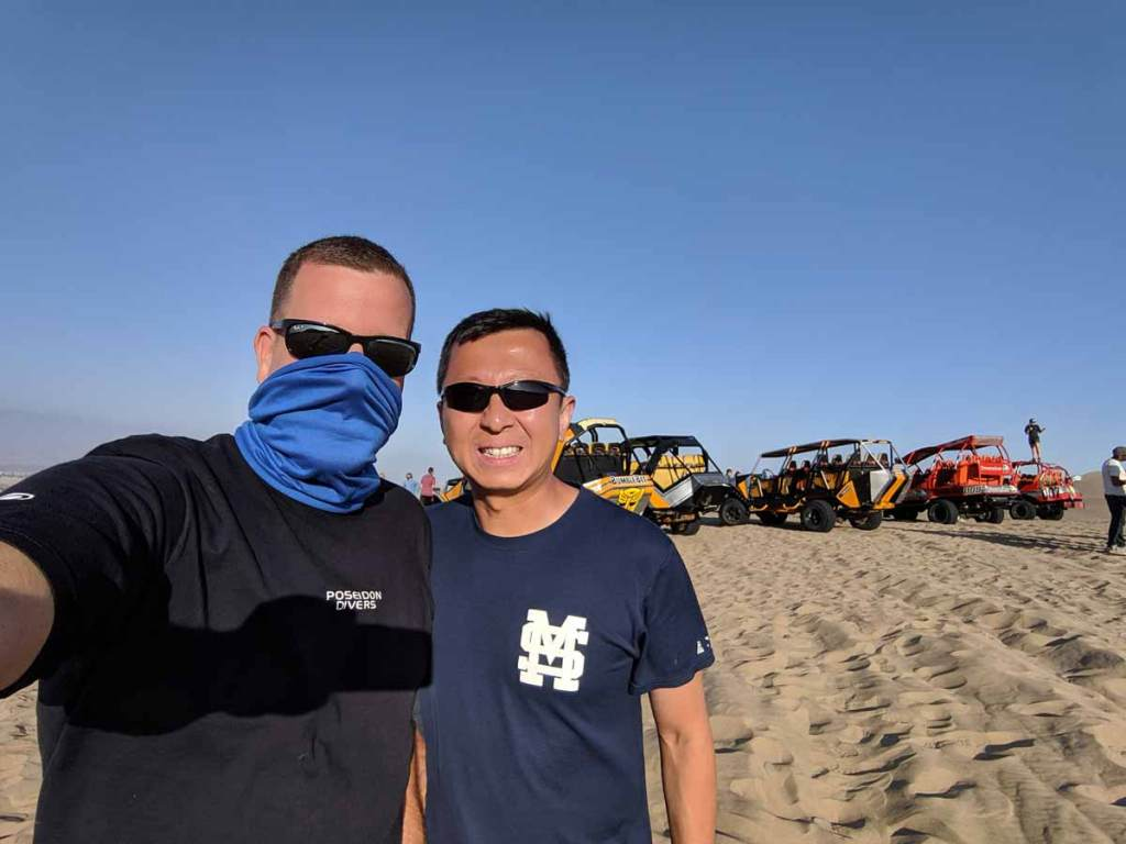 Michael and Halef with dune buggies in Huacachina