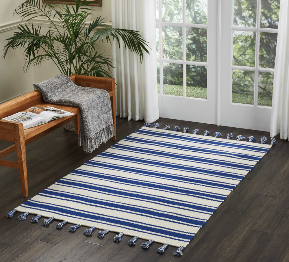 rio vista blue and white striped flat weave rug in sitting room
