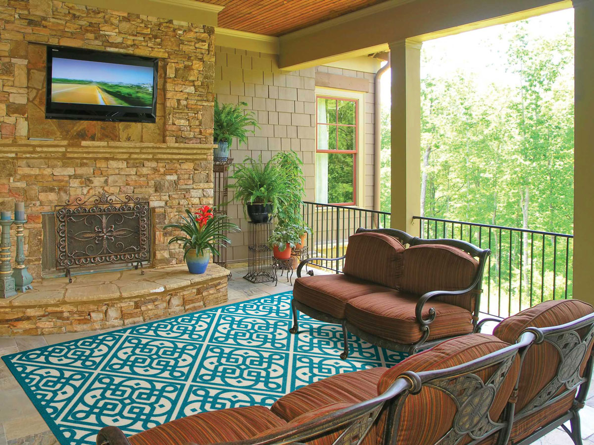 Patio with indoor outdoor rug and outdoor furniture