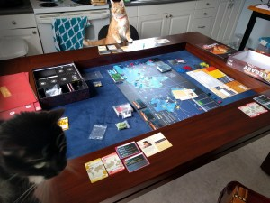 The inaugural game of Pandemic: Legacy. Simon and River insist on playing too.