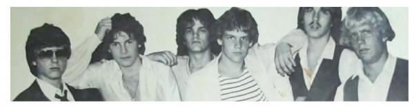 Marc Woodworth (striped shirt) next to Gary Waleik (mustache) in high school
