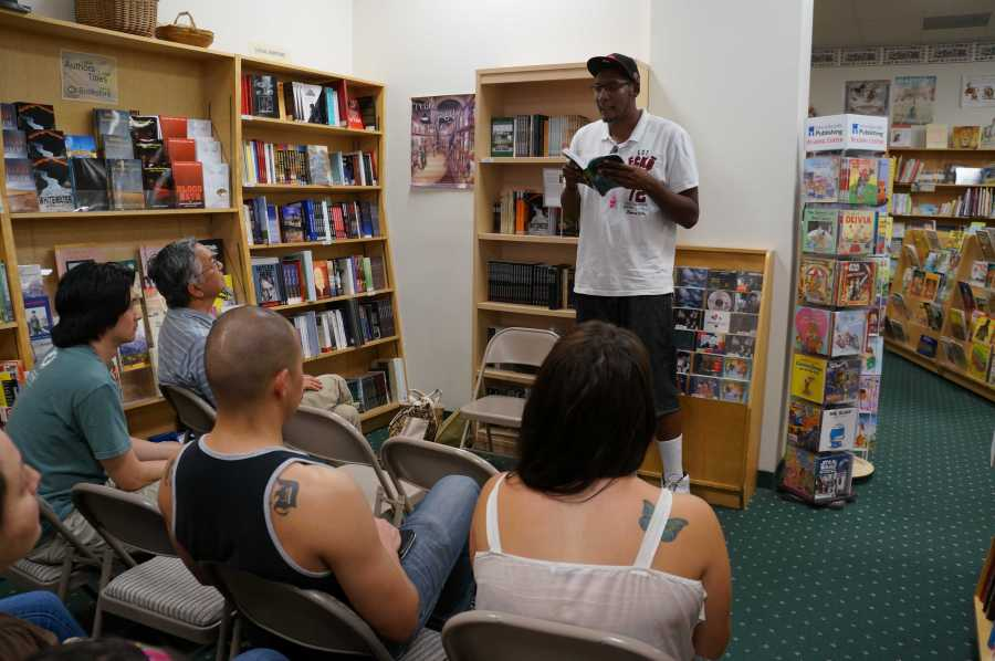 Shamir Griffin reads his poetry to the audience at Russo's. (Ryan Barrera/The Runner).