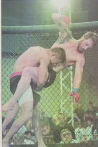 Former CSUB wrestler gets slammed down at Bakersfield MMA event. Photo from The Runner Archives.