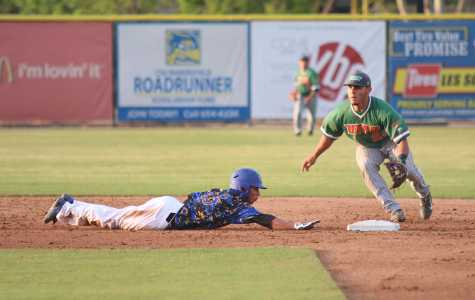 Sophomore David Metzgar dives safely back to the base on a pick off move from Texas Pan-American.