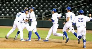 The CSUB baseball team rushed the field after sophomore Joey Sanchez's walk-off walk gave the Roadrunners a 6-5 win on May 23 at Hohokam Stadium. Photo by Darryl Webb/WAC