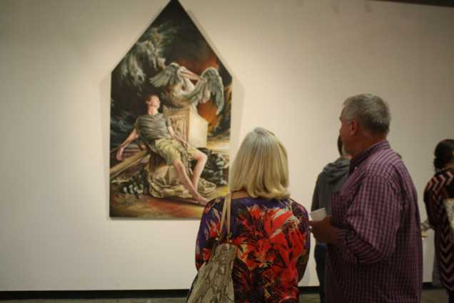 Two guest admiring the work of Luke Boyd at the opening of Nexus senior art exhibition on Thursday, May 14 at Todd Madigan Gallery