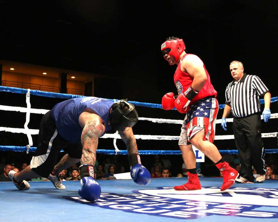 Tim King Jr. KCSO(right) watches as his opponent falls to the ground after he landed a hard punch to the head of Steven Turney (left) KCSO. AJ Alvarado/The Runner