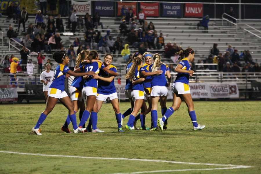 The CSUB women's soccer team celebrates after redshirt-freshman forward Aminah Settles scores a goal to put the Roadrunners up 2-0 in the second half against the Aggies at last year's Western Athletic Conference Tournament. Photo by Karina Diaz/The Runner