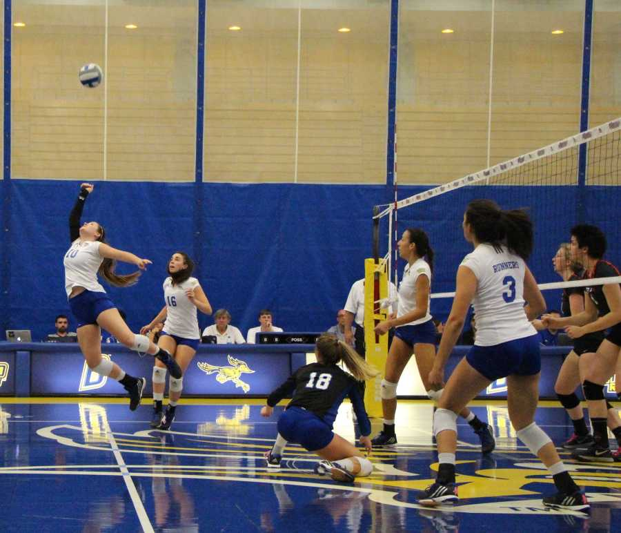 CSUBs+freshman+defensive+specialist+Morginne+Demarco+attempts+to+save+a+point+against+Seattle+University+on+Thursday+in+the+Icardo+Center.+CSUB+beat+Seattle%2C+3-1.%0APhoto+by+Marisel+Maldonado%2FThe+Runner