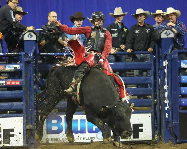 Derek Kolbaba riding his 4th bull of the night after being granted rerides he managed to pull off the win for the night.