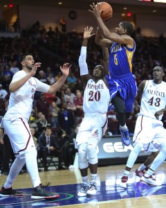 Junior guard Dedrick Basile goes for a shot against New Mexico State. Photo by AJ Alvarado/The Runner