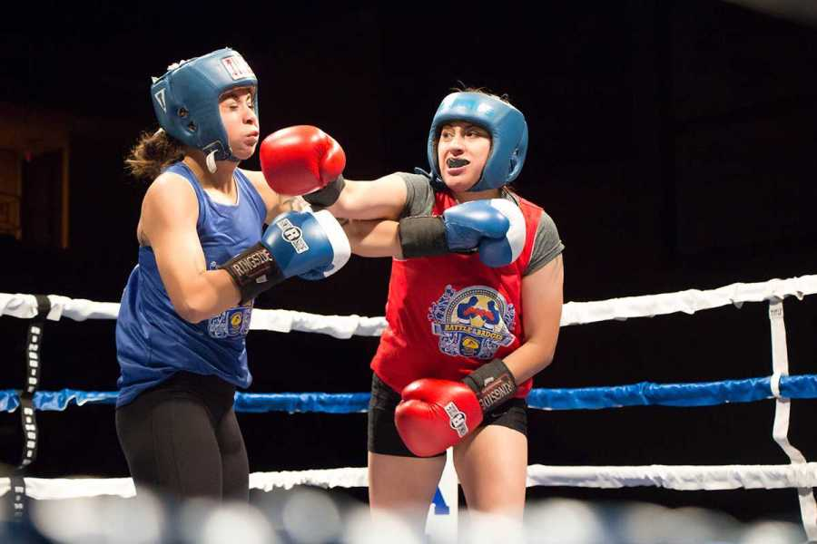 Elizabeth Alvarez of Tehachapi Police Department lands a damaging right to Lorena Vasquez of Bakersfield Police Department on Friday, May 20 at the Icardo Center. Photo by Trevante Hammonds/The Runner