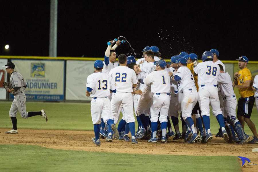 Trevante Hammonds The team rushes the field and sprays water on david metzgar on Friday, May 13 after a win at Hardt field.