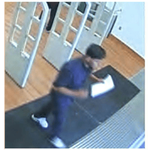 The suspect is pictured above walking out of the library.
