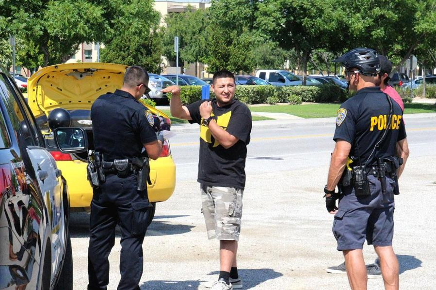 Two male law breakers get searched and cited by  UPD on May 10. Photo By Chris Mateo/The Runner