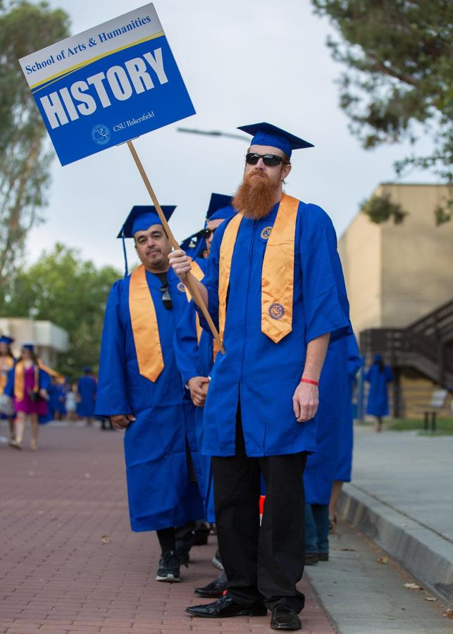 CSUB graduates pose for a photo.