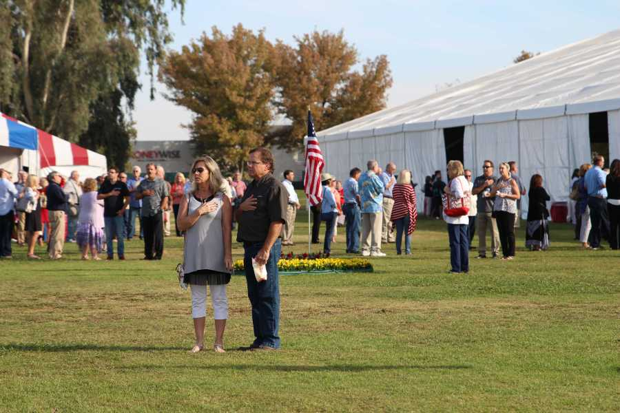 Attendees of all around the country stop to pledge to the flag during the national anthem. By Karina Diaz