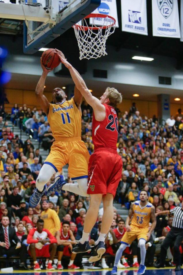 CSUB's redshirt-senior forward Jaylin Airington goes up for a layup against Fresno State's guard Sam Bittner during Tuesday's game. Airington finished with a game-high 28 points. Photo by AJ Alvarado/The Runner