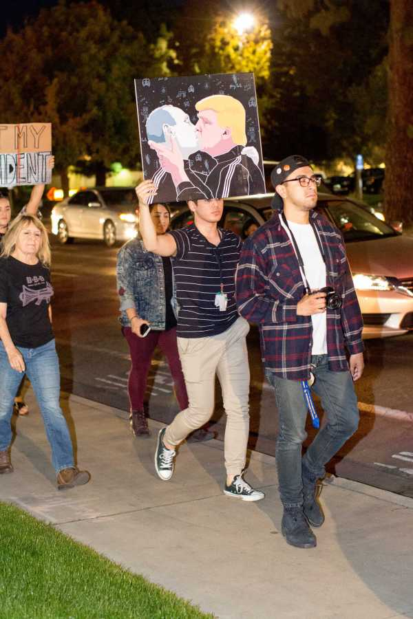 Protesters chanted not my president and love trumps hate at the protest in southwest Bakersfield Friday, Nov. 11. Photo by AJ Alvarado/The Runner