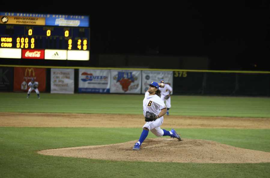 CSUB sophomore pitcher Isaiah Moten delivers a pitch against UC Santa Barbara on Tuesday, Feb. 21 at Hardt Field. Photo by Karina Diaz/The Runner