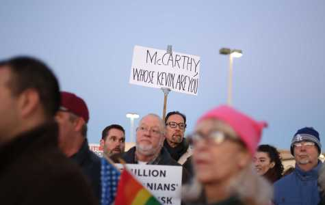 Protesters marched with their signs hoping to get House Majority Leader Kevin McCarthy's attention on Thursday, Feb. 23. Photo by Karina Diaz/The Runner