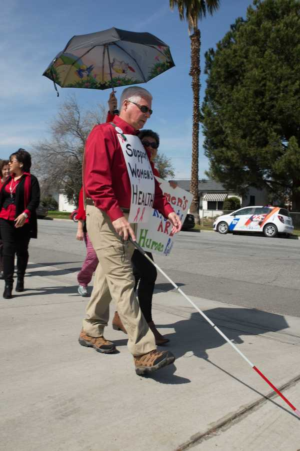 Bill Jones of Bakersfield marched with 40 others Sloan Holmes in downtown Bakersfield Wednesday, March 8. Photo by AJ Alvarado/The Runner