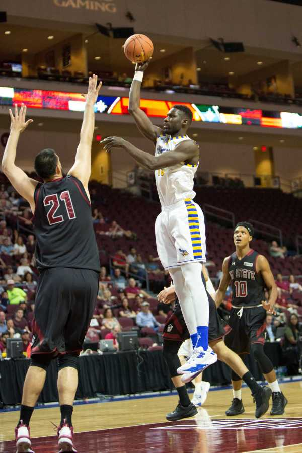 Junior center Fallou Ndoye  goes up for a baby hook against New Mexico State Saturday, March 11.