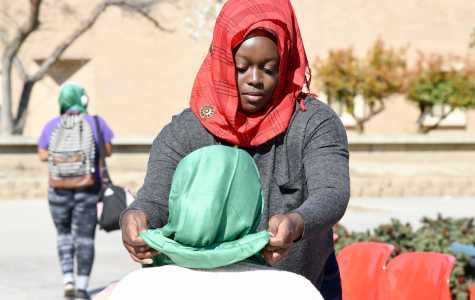 Zainab Okikioposu, 20, helps put the Hijab on students throughout the day.