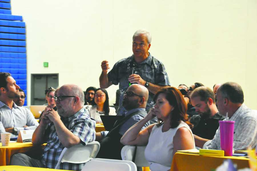 Dr. John Tarjan, along with other faculty members, asks CSUB President MItchell about upcoming budgetary measures at a CSUB budget meeting on Aug. 24, in the Icardo Center. Photo by Jarad Mann/ The Runner